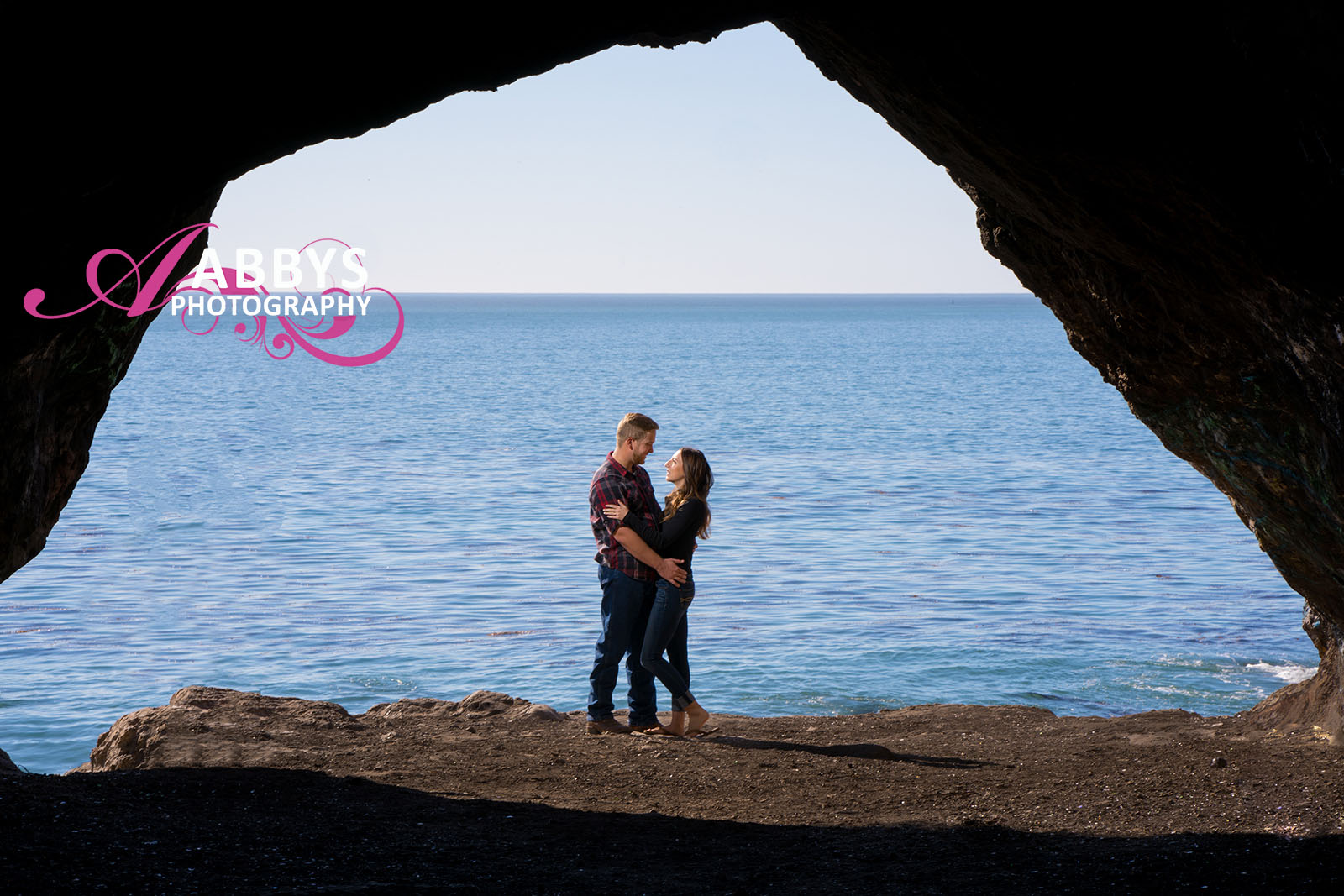 A beautiful couple uses the ocean for the best engagement photography.