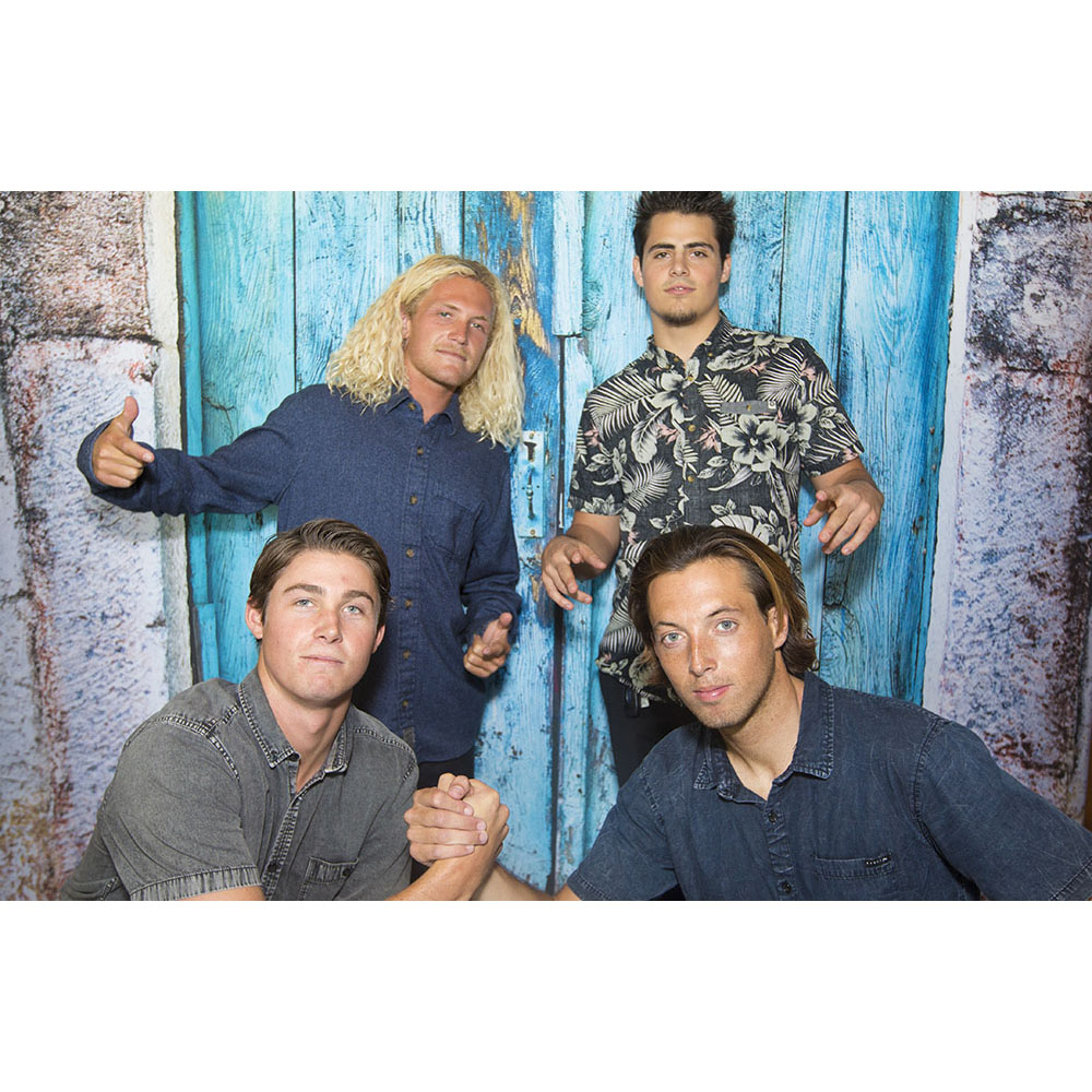 A photo booth custom backdrop offers the opportunity to let Bakersfield bros be themselves.