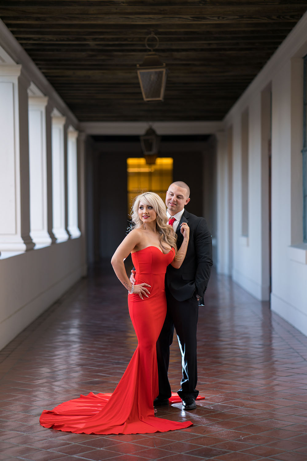 What do you notice? The red dress, right? That's because of the engagement photography.